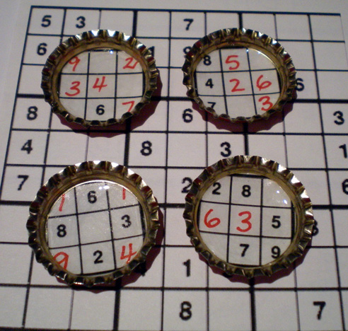 Bottle cap Sudoku magnets