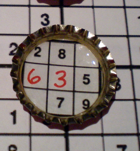 Bottle cap Sudoku magnets detail