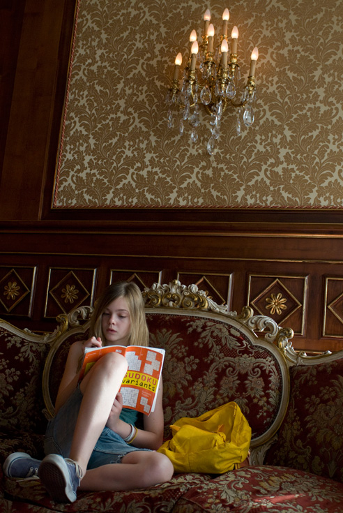 Cleo takes a Sudoku break on the hotel lobby sofa. Photographer: Franco Biciocchi