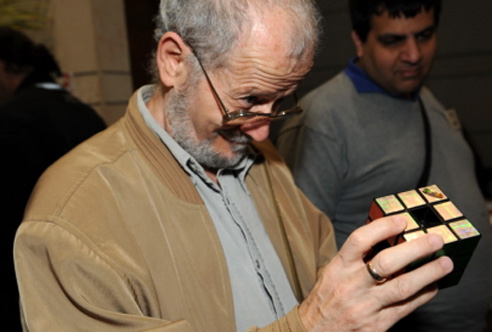 Dan Feldman, a well-known puzzle collector and a former organizer of the conference, examines a variation of Rubik's cube.