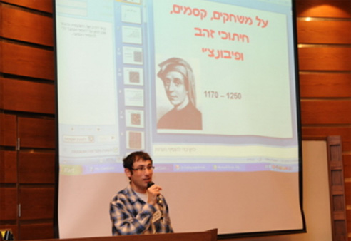 Dr. Yossi Elran, the conference organizer, welcomes the crowd.