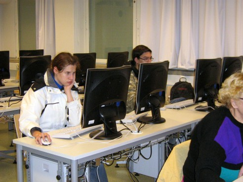 Students solving a Color Pic-a-Pix on their computers at different paces, all are very concentrated